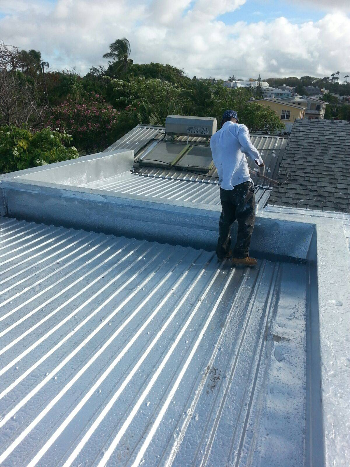 Waterproofing a roof at Warrens Terrace Christ Church with Tecma Imperal P-91